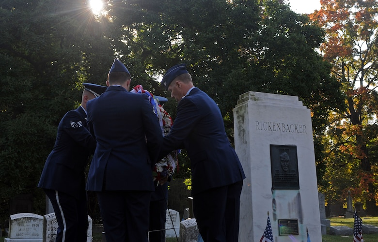 """U.S. Airmen with the 121st Air Refueling Wing, along with members of the Columbus Downtown High School Jr. ROTC and the Rickenbacker-Woods Foundation, join together to celebrate the 125th birthday of Capt. Eddie Rickenbacker Oct. 8, 2015 at Green Lawn Cemetery, Columbus, Ohio. October 8 has officially been named by The Franklin County Board of Commissioners as """"Captain Eddie Rickenbacker Day"""" for the City of Columbus. (U.S. Air National Guard photo by Airman 1st Class Ashley Williams/Released)"""