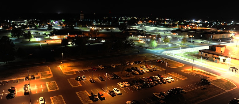 The 509th Civil Engineer Squadron engineers recently replaced fluorescent lights (bottom left) with light-emitting diode (LED) lights (top right)  at Whiteman Air Force Base, Mo., Oct. 21, 2015. LED lights eliminate light pollution, directing light towards the ground and producing accurate color rendition. The lights also have a ten year life expectancy which reduces cost and manpower. (U.S. Air Force photo by Senior Airman Joel Pfiester/Released)