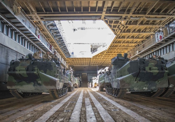 WATERS OFF OKINAWA, Japan – Amphibious assault vehicles wait in the well deck of the amphibious dock landing ship USS Germantown (LSD 42) before launching to head ashore for a personnel swap during exercise Blue Chromite (BC) 16. BC 16 is a U.S. only exercise designed to increase amphibious proficiency between the Navy and Marine Corps. (U.S. Navy photo by Mass Communication Specialist 2nd Class Will Gaskill/Released)