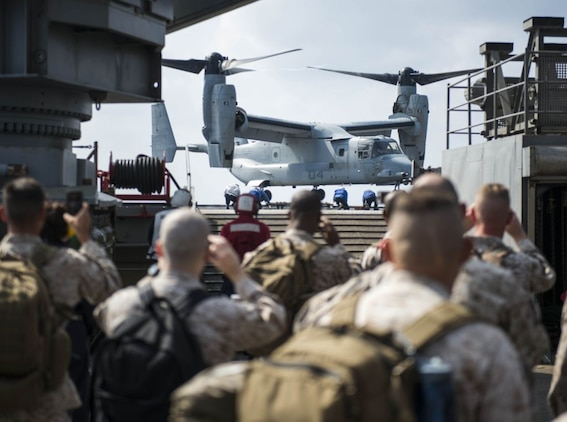 WATERS OFF OKINAWA, Japan – Sailors and Marines look on while a MV-22 Osprey aircraft lands on the flight deck aboard the amphibious dock landing ship USS Germantown (LSD 42) during exercise Blue Chromite (BC) 16. BC 16 is a U.S. only exercise designed to increase amphibious proficiency between the Navy and Marine Corps. (U.S. Navy photo by Mass Communication Specialist 2nd Class Will Gaskill/Released)