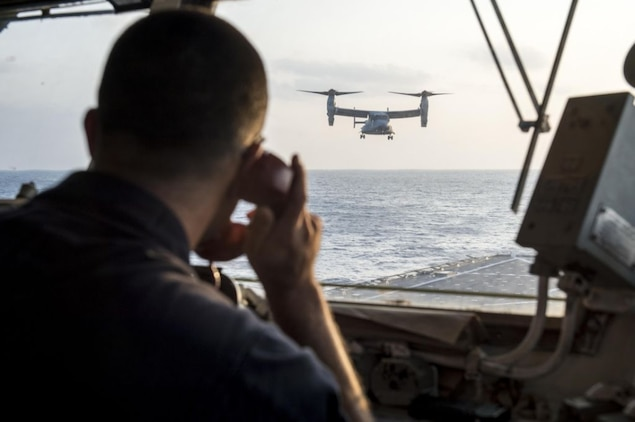 WATERS OFF OKINAWA, Japan – Senior Chief Culinary Specialist C. Wade Wilson, aircraft control officer aboard the amphibious dock landing ship USS Germantown (LSD 42), communicates with a MV-22 Osprey aircraft while landing on the flight deck aboard the ship during exercise Blue Chromite (BC) 16. BC 16 is a U.S. only exercise designed to increase amphibious proficiency between the Navy and Marine Corps. (U.S. Navy photo by Mass Communication Specialist 2nd Class Will Gaskill/Released)