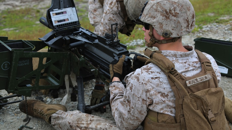 Cpl. Christopher Roseblossom operates a MK-19 during an M67 fragmentation grenade and MK-19 Grenade Launcher range at Marine Corps Base Camp Lejeune, N.C., Oct. 28, 2015. More than 70 Marines with 2nd Low Altitude Air Defense Battalion took turns handling the MK19 and handheld grenades during the familiarization range. The range offered Marines the opportunity to build confidence and proficiency skills on some of the crew-served weapons they operate while providing security in a deployed environment. Roseblossom is a low altitude aerial defense gunner with the battalion.