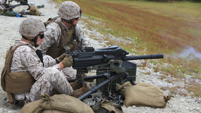 Marines engage designated targets during a grenade and MK-19 Grenade Launcher range at Marine Corps Base Camp Lejeune, N.C., Oct. 28, 2015. More than 70 Marines with 2nd Low Altitude Air Defense Battalion took turns handling the MK19 and handheld grenades during the familiarization range. The range offered Marines the opportunity to build confidence and proficiency skills on some of the crew-served weapons they operate while providing security in a deployed environment.