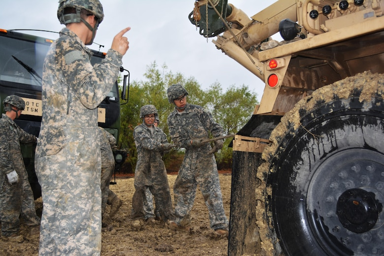 Students attending the Wheeled Vehicle Recovery Course at Regional Training Site Maintenance-Fort Hood, Texas, conduct recovery operations Oct. 23, 2015. The course teaches Army mechanics how to properly and safely recover and tow vehicles that may be stuck or inoperable.
