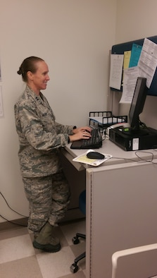 Capt. Jennifer Varney, a family nurse practitioner and family health flight commander, checks MiCARE for patient requests at the Family Health Clinic at Maxwell Air Force Base, Ala. (Courtesy photo)