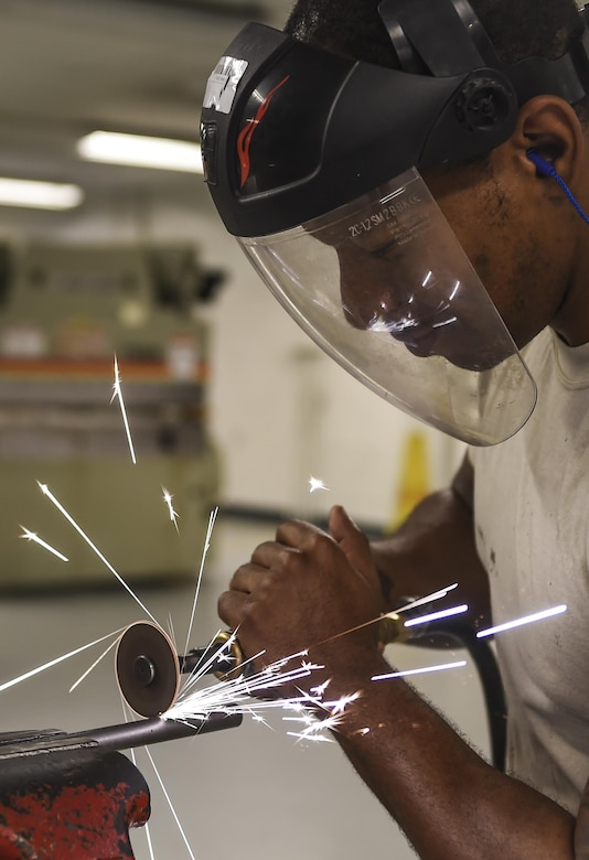 Staff Sgt. Sean Ciccel, 1st Special Operations Maintenance Squadron aircraft structural maintenance craftsman, uses a cutting wheel to cut aircraft tubing at Hurlburt Field, Fla., Oct. 22, 2015. The 1st SOMXS aircraft structural maintenance Airmen construct aircraft parts for the CV-22B Osprey, AC-130U Spooky, MC-130H Combat Talon II and the AC-130J Ghostrider. (U.S. Air Force photo by Senior Airman Christopher Callaway/Released)