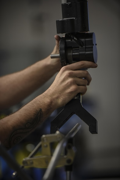 Senior Airman Dalton Obenshain, 1st Special Operations Maintenance Squadron aircraft structural maintenance journeyman, uses a laser arm to mimic the curve of aircraft tubing on new tubes, at Hurlburt Field, Fla., Oct. 22, 2015. Airmen with the 1st SOMXS aircraft structural maintenance save the Air Force more than $100,000 a year, replacing damaged parts with items fabricated in their shop. (U.S. Air Force photo by Senior Airman Christopher Callaway/Released)