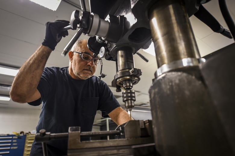 Ali Hooshmand, 1st Special Operations Maintenance Squadron, uses a drill press to complete a work order on Hurlburt Field, Fla., Oct. 22, 2015. The members that work in sheet metal use advanced equipment and techniques to reverse engineer and manufacture aircraft parts. (U.S. Air Force photo by Senior Airman Christopher Callaway/Released)