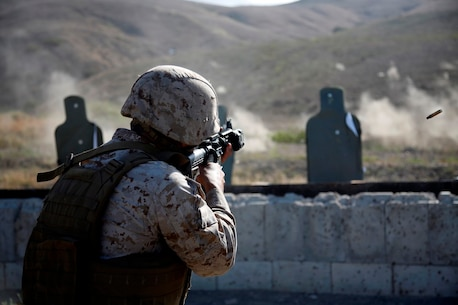 A U.S. Marine with 11th Marine Expeditionary Unit (MEU) fires an M4 Carbine as part of combat marksmanship training during the 11th MEU Command Element field exercise (CEFEX) at Camp Pendleton, Calif. Combat marksmanship training teaches Marines weapon familiarity and marksmanship enhancement, as well as maintaining developed skills in preparation for the WestPac 16-2 deployment. (U.S. Marine Corps photo by Cpl. Xzavior T. McNeal)