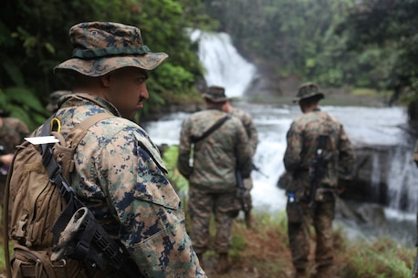 Cpl. Renatto Aguilar, administrative clerk for KOA MOANA 15-3, takes a break after hiking in the jungle during a training exercise in Namosi Province, Fiji, Oct. 13. Marines also helped build up the local communities during the evolution.