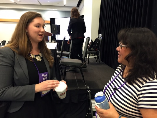 """U.S. Army Corps of Engineers employee Lannae Long, an environmental engineer from the Nashville District talks with a college student during the Society of Women Engineers conference Oct. 24, 2015 at the Music City Center Convention Center in Nashville, Tenn.   Long spoke a on """"Working with the Federal Government"""" during a question and answer session Saturday afternoon.  U.S. Army Corps of Engineers representatives networked with thousands of college engineering students at the conference. This year's theme was """"Reach out to reach up."""""""