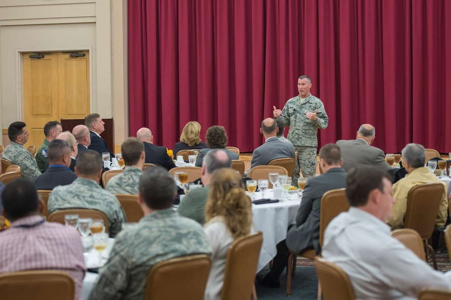 "Maj. Gen. Ed Wilson, 24th Air Force commander speaks to attendees of the 2015 AF Cyberspace Live, Virtual and Constructive (LVC) Workshop on Joint Base San Antonio - Lackland, Texas, October 20. The three-day LVC workshop is co-chaired by 24 AF and the Air Force Agency for Modeling and Simulation (AFAMS). The theme of the workshop is ""Training the Cyber Mission Force."" As the leader in realistic Cyber training, the AF seeks to integrate air, space, and cyberspace training through its full-spectrum LVC capabilities. (U.S. Air Force photo by Master Sgt. Luke P. Thelen/Released)"