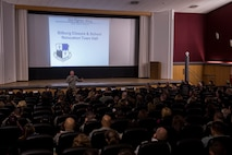 U.S. Air Force Col. Joseph McFall, 52nd Fighter Wing commander, speaks during a town hall meeting inside the base theater Oct. 30, 2015, Spangdahlem Air Base, Germany. McFall and other 52nd FW leadership spoke to parents and teachers about the upcoming school move during the event. (U.S. Air Force photo by Senior Airman Rusty Frank/Released)