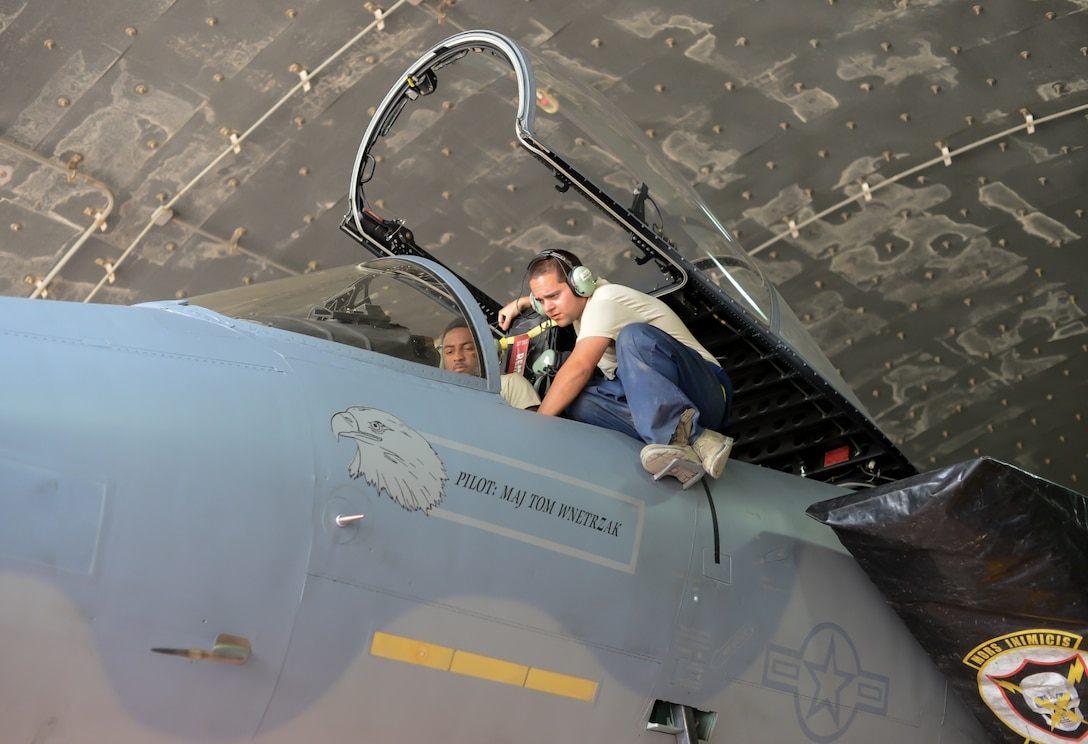 Airman 1st Class John Gates and Staff Sgt. Aaron Ornellss, 493rd Aircraft Maintenance Unit, Royal Air Force, Lakenheath, test the flight control system of an F-15C Eagle during the Blue Flag exercise Oct. 19, 2015, at Uvda Air Force Base, Israel. The exercise was conducted from Oct. 18-29 and allowed visiting nations' air forces the opportunity to train in a desert environment while completing missions with partner nations. (U.S. Air Force photo by 2nd Lieutenant Kellie Rizer)