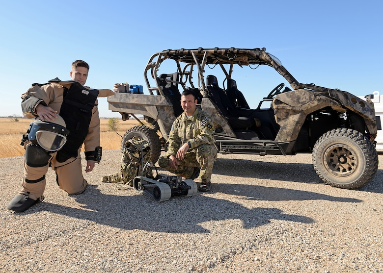 Master Sgt. Jayson Wells (right), 9th Civil Engineer Squadron Explosive Ordnance Disposal flight chief, and Senior Airmen Daniel Fox, 9th CES EOD flight technician, pose for a photo Oct. 29, 2015, at Beale Air Force Base, California. Wells helped and mentored Fox to cross train into the EOD career field. (U.S. Air Force photo by Airman 1st Class Ramon A. Adelan)