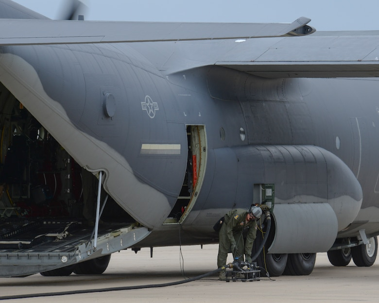 U.S. Air Force Master Sgt. Michael Mueller, 79th Rescue Squadron loadmaster, sets up a defuel pump connected to an HC-130J Combat King II during Forward Area Refueling Point training at Davis-Monthan Air Force Base, Ariz., Oct. 15, 2015. The FARP capability allows for projection of combat power and rescue forces from an infinite number of locations around the world. (U.S. Air Force photo by Senior Airman Chris Massey/Released)