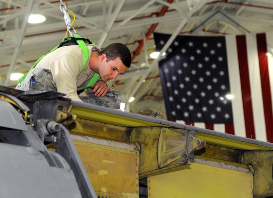 Staff Sgt. Andrew Depew, 127th Aircraft Maintenance Squadron, aircraft structural maintenance craftsman, repairs a panel on a KC-135 Stratotanker in the hangar at Selfridge Air National Guard Base, Mich., Oct. 18, 2015. Depew is responsible for any structural repairs or maintenance on the KC-135 Stratotanker. (U.S. Air Force photo by Senior Airman Ryan Zeski/Released)