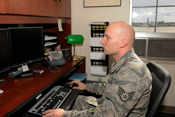 Staff Sgt. Nick Smith works at his desk with the 127th Logistics Readiness Squadron at Selfridge Air National Guard Base, Oct. 17, 2015. After serving for several years on active duty, the Airman wanted to return home but continue to serve. He found his opportunity in the Michigan Air National Guard. (U.S. Air National Guard photo by Master Sgt. David Kujawa)