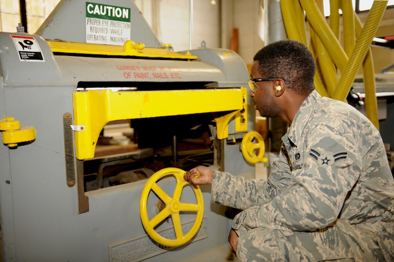 151017-Z-EZ686-021 – Airman 1st Class John Pitts of the 127th Civil Engineering Squadron, Selfridge Mich., is making adjustment on the work shop planer, used for resurfacing wood at Selfridge Air National Guard Base Mich., October 17, 2015.  Pitts is a newly affiliated member of the CE Squadron, who recently graduated from technician school where he learned the art of working on buildings and structures.  (U.S. Air National Guard photo by MSgt. David Kujawa/Released)