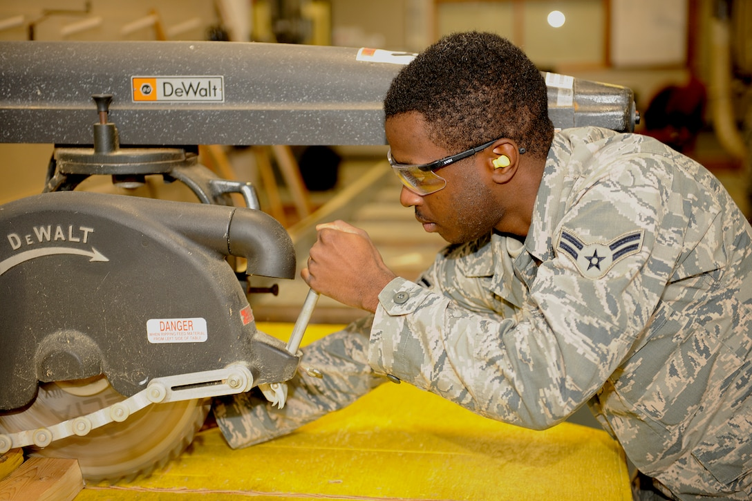 151017-Z-EZ686-018 – Airman 1st Class John Pitts of the 127th Civil Engineering Squadron, Selfridge Mich., is cutting some wood with a table saw at Selfridge Air National Guard Base Mich., October 17, 2015.  Pitts is a newly affiliated member of the CE Squadron, who recently graduated from technician school where he learned the art of working on buildings and structures.  (U.S. Air National Guard photo by MSgt. David Kujawa/Released)