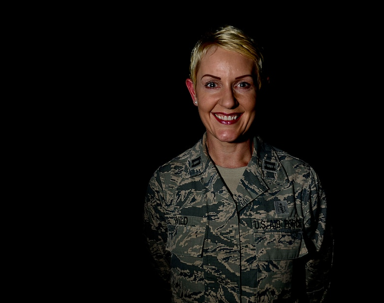 Capt. Elaina Wild, 39th Medical Support Squadron family practice primary care provider, poses for a photo April 24, 2015, at Incirlik Air Base, Turkey. Wild is a native of Zimbabwe who studied medicine in the U. S., became a citizen of the United States of America and joined the U.S. Air Force. (U.S. Air Force photo by Staff Sgt. Eboni Reams/Released)