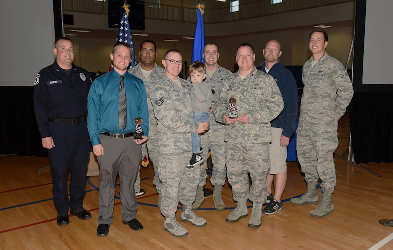 460th Space Wing quarterly award winners stand together after a ceremony Oct. 29, 2015, at the fitness center on Buckley Air Force Base, Colo. Each nominee had to submit a package and in front of a board to compete for the winning title. (U.S. Air Force photo by Airman 1st Class Samantha Meadors/Released)