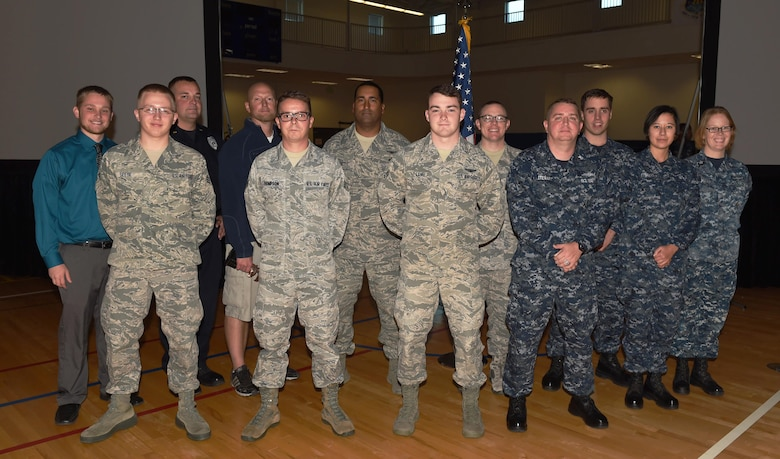 Team Buckley quarterly award winners stand together after a ceremony Oct. 29, 2015, at the fitness center on Buckley Air Force Base, Colo. Each nominee had to submit a package and go in front of a board to compete for the winning title. (U.S. Air Force photo by Airman 1st Class Samantha Meadors/Released)