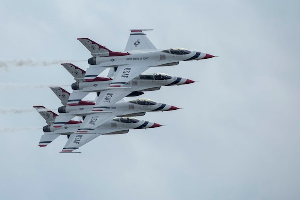 "JBSA-Randolph - The U.S. Air Force Aerial Demonstration Squadron ""Thunderbirds"" performs F-16 acrobatic maneuvers Oct. 31, 2015 at Joint Base San Antonio-Randolph, Texas. The Thunderbirds team members perform for the 2015 JBSA-Randolph Air Show and Open House to be held Oct. 31 and Nov. 1. Air shows allow the Air Force to display the capabilities of our aircraft to the American taxpayer through aerial demonstrations and static displays and allowing attendees to get up close and personal to see some of the equipment and aircraft used by the U.S. military today. (U.S. Air Force photo by Joshua Rodriguez)"