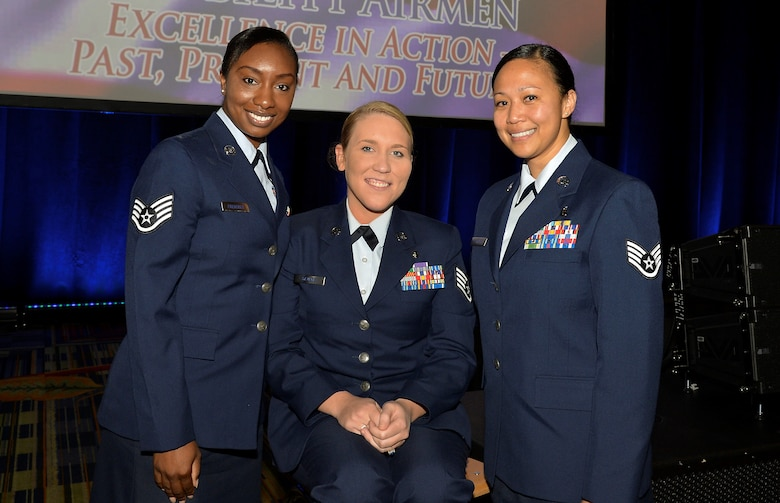 (From Left) Staff Sgts. Amber Fredericks, Taylor Savage and Maria Szymanski, combat medics, pose for a group photo during the 47th Annual Airlift Tanker Association Convention and Technology Exposition and A/TA and AMC Symposium in Orlando, Fla., Oct. 31, 2015. The medics were reunited at this year's closing keynote address. (U.S. Air Force photo by Staff Sgt. Shandresha Mitchell/Released)