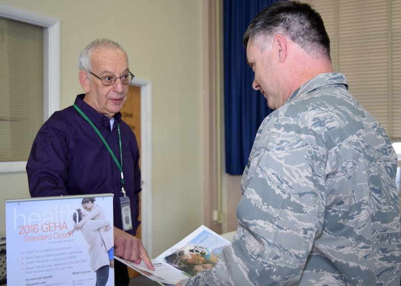 Representatives from a variety of government health care insurers gathered at the Horsham Air Guard Station, Horsham, Pennsylvania, Oct. 29,2015 during a health fair for civilian government employees and military technicians. Maj. Bennie Roberson, 111th Attack Wing inspector general, shown right, discusses healthcare options with Sid Severe, contract representative with Government Employee Health Association. (U.S. Air National Guard photo by Master Sgt. Christopher Botzum/Released)