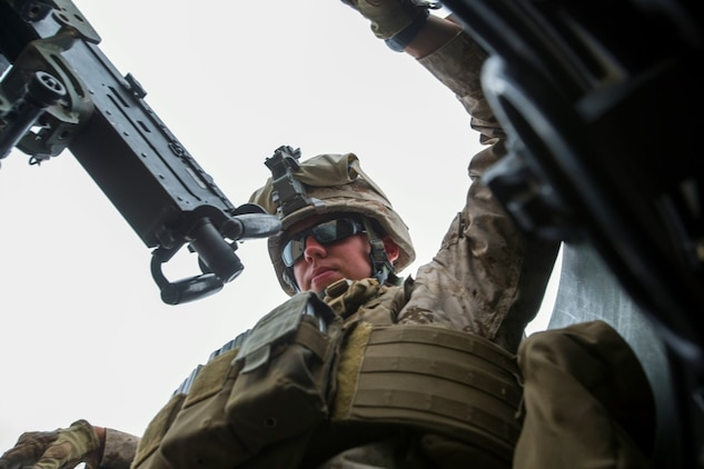 Corporal Jordan Kischel, a gunner with 3rd Low Altitude Air Defense Battalion, Marine Air Control Group 38, 3rd Marine Aircraft Wing, maintains security with an M2 .50 caliber machine gun in the turret of a tactical vehicle during a convoy air-defense exercise aboard Marine Corps Base Camp Pendleton, Calif., Aug. 25, 2015. The exercise gave the Marines the opportunity to work with a simulated enemy aircraft, an AH-1Z Cobra helicopter provided by Marine Light Attack Helicopter Squadron 169, Marine Aircraft Group 39, 3rd MAW. Realistic training allows Marines to remain effective in increasingly complex environments around the world. (U.S. Marine Corps photo by Lance Cpl. Caitlin Bevel)