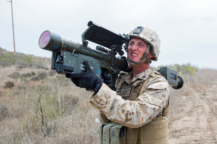 Corporal John Graham, a gunner with 3rd Low Altitude Air Defense Battalion, Marine Air Control Group 38, 3rd Marine Aircraft Wing, aims a dummy FIM-92 anti-aircraft weapon during a convoy air-defense exercise aboard Marine Corps Base Camp Pendleton, Calif., Aug. 25, 2015. The exercise gave the Marines the opportunity to work with a simulated enemy aircraft, an AH-1Z Cobra helicopter provided by Marine Light Attack Helicopter Squadron 169, Marine Aircraft Group 39, 3rd MAW. Realistic training allows Marines to remain effective in increasingly complex environments around the world. (U.S. Marine Corps photo by Lance Cpl. Caitlin Bevel)