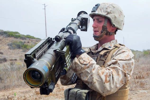 Corporal John Graham, a gunner with 3rd Low Altitude Air Defense Battalion, Marine Air Control Group 38, 3rd Marine Aircraft Wing, prepares a dummy FIM-92 anti-aircraft weapon during a convoy air-defense exercise aboard Marine Corps Base Camp Pendleton, Calif., Aug. 25, 2015. The exercise gave the Marines the opportunity to work with a simulated enemy aircraft, an AH-1Z Cobra helicopter provided by Marine Light Attack Helicopter Squadron 169, Marine Aircraft Group 39, 3rd MAW. Realistic training allows Marines to remain effective in increasingly complex environments around the world. (U.S. Marine Corps photo by Lance Cpl. Caitlin Bevel)