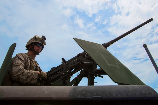 Corporal Jordan Kischel, a gunner with 3rd Low Altitude Air Defense Battalion, Marine Air Control Group 38, 3rd Marine Aircraft Wing, maintains security with an M2 .50 caliber machine gun in the turret of a Humvee tactical vehicle during a convoy air-defense exercise aboard Marine Corps Base Camp Pendleton, Calif., Aug. 25, 2015. The exercise gave the Marines the opportunity to work with a simulated enemy aircraft, an AH-1Z Cobra helicopter provided by Marine Light Attack Helicopter Squadron 169, Marine Aircraft Group 39, 3rd MAW. Realistic training allows Marines to remain effective in increasingly complex environments around the world. (U.S. Marine Corps photo by Lance Cpl. Caitlin Bevel)