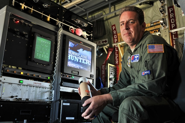 Master Sgt. Jeff Stack, 53rd Weather Reconnaissance Squadron loadmaster, holds a dropsonde while inside a WC-130J, Aug. 26, 2015, Keesler Air Force Base, Miss. Stack flew several missions tracking Hurricane Katrina before it devastated the Gulf Coast. The dropsonde is one of the primary tools the Hurricane Hunters use to accurately track and collect data on tropical storms and hurricanes. (U.S. Air Force photo by Tech. Sgt. Greg C. Biondo)