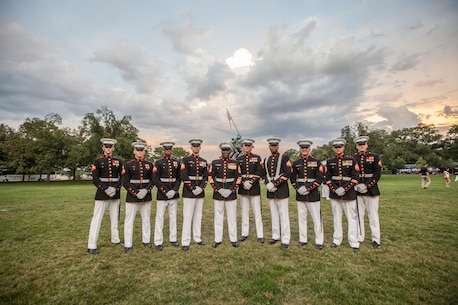 The 18th Sergeant Major of the Marine Corps, Ronald L. Green, hosts a sunset parade at the Marine Corps War Memorial, Arlington, Va., August 11, 2015. The Honorable Mrs. Holly Petraeus, Assistant Director, Service Member Affairs at the Consumer Financial Protection Bureau, was the guest of honor at the parade. (U.S. Marine Corps photo by Sgt. Melissa Marnell, Office of the Sergeant Major of the Marine Corps/Released)