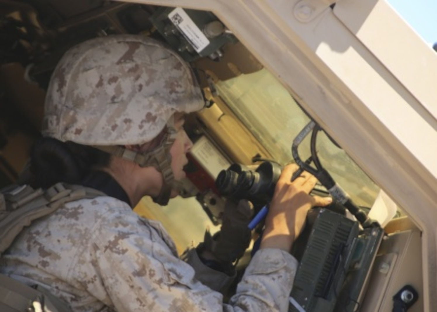 1st Lt. Isabel Marin, a logistics officer with Combat Logistics Battalion 1, Combat Logistics Regiment 1, 1st Marine Logistics Group, watches for artillery strikes after calling for fire support during a mounted patrol exercise aboard Marine Corps Air Ground Combat Center Twentynine Palms, California, Aug. 10, 2015. Marines responded to simulated ambushes with live machine gun, rocket and artillery fire.