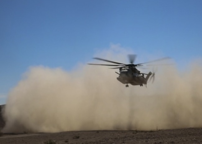 A CH-53E Super Stallion with Marine Heavy Helicopter Squadron 366 descends to a secured landing zone during a simulated casualty evacuation aboard Marine Corps Air Ground Combat Center Twentynine Palms, California, Aug. 10, 2015. The simulation gave Marines with Combat Logistics Battalion 1, Combat Logistics Regiment 1, 1st Marine Logistics Group an opportunity to prepare for casualty response during future operations.