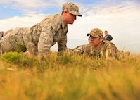 A member of the 27th Special Operations Security Forces Squadron is verbally challenged by Tech. Sgt. Brian Cikity (DAGRE 199), 27th SOSFS DAGRE Program Manager, during a grueling physical, mental and emotional assessment as part of pre-qualification for Deployed Aircraft Ground Response Element selection Aug. 17, 2015 at Cannon Air Force Base, N.M. The DAGRE training program at Cannon has recreated a very rigorous training environment to test and develop Air Commandos who have DAGRE team member aspirations. (U.S. Air Force photo/Senior Airman Chip Slack)