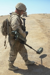 Cpl. Dale Stroud, a Marine with Combat Logistics Battalion 1, Combat Logistics Regiment 1, performs an improvised explosive device sweep in order to locate and remove IEDs from the area during Large Scale Exercise 15 aboard Marine Corps Air Ground Combat Center Twentynine Palms, Calif., Aug. 18, 2015. LSE-15 is a combined U.S. Marine Corps, Canadian and British exercise conducted at the brigade level, designed to enable live, virtual and constructive training for participating forces. (U.S. Marine Corps photo by Lance Cpl. Chris Garcia/Released)