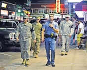 Tanner Monroe, police officer with Riley County Police Department, leads the assigned courtesy patrol officers during duty Friday, Aug. 21. Courtesy patrol is an assigned duty that helps mitigate Soldiers behavior in Aggieville.