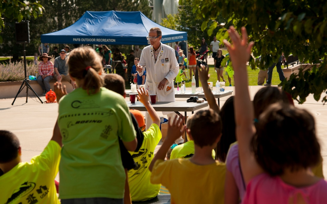 PETERSON AIR FORCE BASE, Colo. – Ronald Furstenau, U.S. Air Force Academy, teaches military families basic chemistry during his chemistry magic show at the Science, Technology, Engineering, and Math event at the Peterson Air and Space Museum, Aug. 29, 2015. The chemistry magic show was one of many topics open to the children during the free annual event including rocket building/launching, a cave simulator, dinosaurs, electricity simulator and more. (U.S. Air Force photo by Senior Airman Tiffany DeNault)
