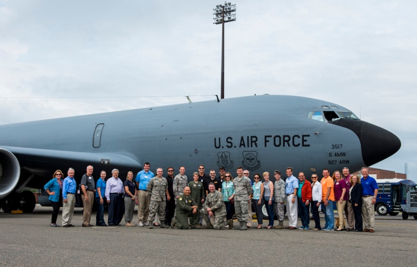 Members of Joint Base Charleston leadership and civic leaders from Macdill Air Force Base pose for a group photo together in front of a KC-135 Stratotanker, Aug. 27, 2015, at Joint Base Charleston, S.C. The Macdill Civic Leaders tour was an opportunity to show visiting Honorary Commanders and Advisory Council members the capabilities of JB Charleston. (U.S. Air Force photo/Senior Airman George Goslin)