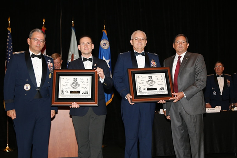 Maj. Gen. Joe Vazquez, Civil Air Patrol National Commander,  flanks CAP members Maj. Justin Ogden and Col. Brian Ready, along with John Griffin, 1st Air Force (Air Forces Northern) Chief of Staff, during the Civil Air Patrol annual awards ceremony Aug. 29.  Ogden and Ready received the 2014 AFNORTH Commander's Award for their work on CAP's Cell Phone Forensics Team. (Photo Released by Susan Schneider/CAP National Headquarters)
