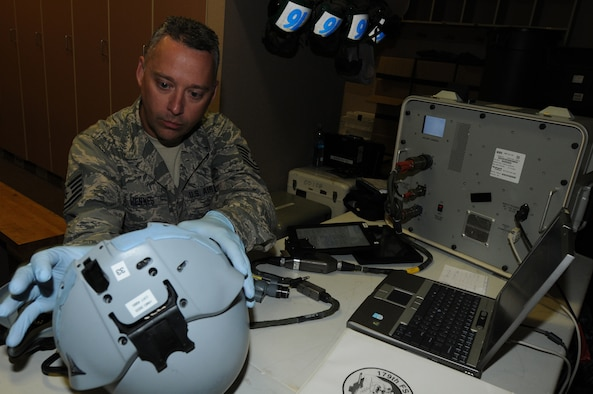 U.S. Air Force Tech. Sgt. Richard Hennes, a 148th Fighter Wing aircrew flight equipment craftsman from Duluth, Minn., performs a pre-flight inspection on a pilot's helmet, Aug. 10, 2015, while participating in RED FLAG-Alaska 15-3 at Eielson Air Force Base, Alaska.  RF-A is a Pacific Air Forces commander-directed field training exercise for U.S. and partner nation forces, providing combined offensive counter-air, interdiction, close air support and large force employment training in a simulated combat environment.  (U.S. Air Force photo by Master Sgt. Ralph Kapustka/Released)