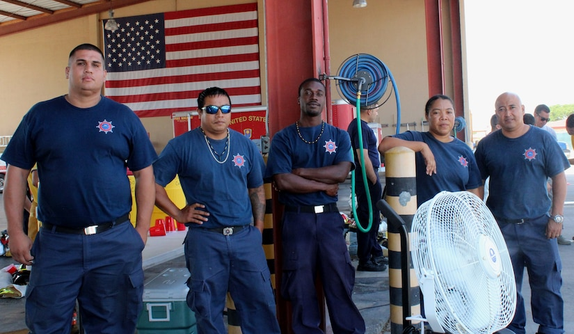 SOTO CANO AIR BASE, Honduras - Firefighters representing the Belize National Fire Service pose for a group picture during the Fire Ground Physical Challenge, Aug. 25, 2015, during CENTAM SMOKE, a quarterly exercise hosted by Joint Task Force-Bravo at Soto Cano Air Base, Honduras.  CENTAM SMOKE allows participants to share experiences and mutual knowledge in order to develop lasting relationships and to improve interoperability between nations.  (U.S. Army photo by Maria Pinel)