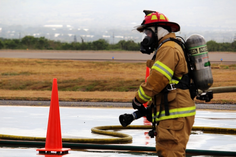 SOTO CANO AIR BASE, Honduras - Miguel Matus, a firefighter form the Belize nNational Fire Service, prepares for a mobile aircraft fire practice Aug. 26, 2015, during CENTAM SMOKE, a quarterly firefighting exercise hosted by Joint Task Force-Bravo at Soto Cano Air Base, Honduras. During this practice, students learned how to combat live fires in the cockpit, engine, fuselage and ground areas of the aircraft to build partnership and improve interoperability.  (U.S. Army photo by Maria Pinel)