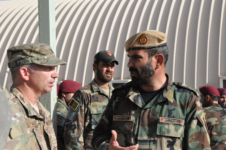 Helmand, Afghanistan (July 25, 2015) - U.S. Air Force Col. Donald Holloway, Resolute Support Advise and Assist Cell-Southwest team lead and Lt.Col. Zabihullah Mohmand, Commander, ANA 7th Special Operations Kandak meet for a quick exchange after a 7th SOK command address.