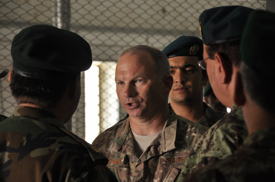 Helmand, Afghanistan (July 25, 2015) - U.S. Air Force Col. Donald Holloway, Resolute Support Advise and Assist Cell-Southwest team lead catches up with Maj. Gen. Eqbil Ali Afghan Ministry of Defense General Staff, G6, Communications  after a the general addressed ANA 215th Corps at Camp Shorab.
