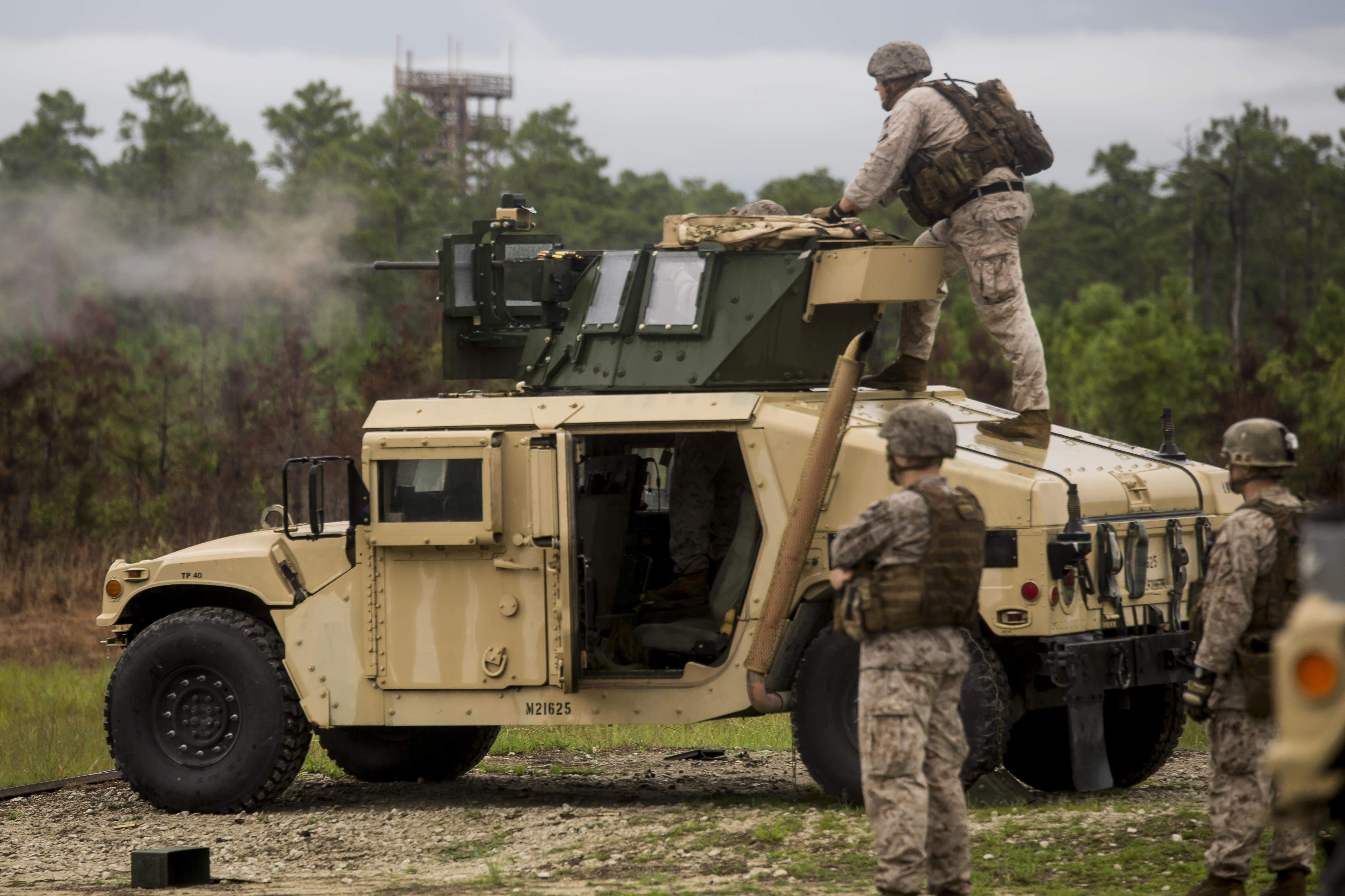 A Marine with 2nd Air Naval Gunfire Liaison Company, II Marine Expeditionary Force shoots an